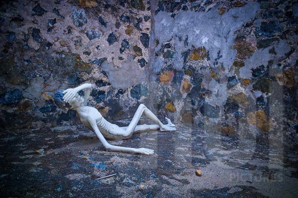 Mannequin representing a starved political prisoner at Phu Tuong prison, known as the 'French Tiger Cages' in Con Dao, Ba Ria - Vung Tau Province, Vietnam, Southeast Asia