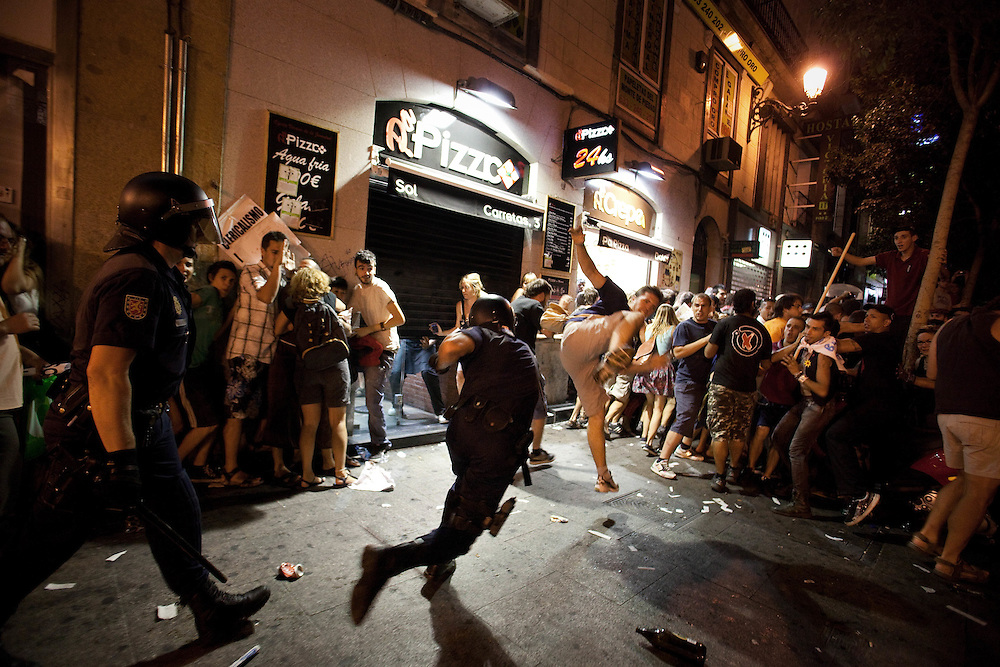 Riot police officer clash with demostrators following a protest against the next Pope Benedict XVI visit in Madrid on Wednesday, Aug. 17, 2011. Pope Benedict XVI is due to arrive Thursday for a nearly four-day visit to celebrate World Youth Day, and thousands of protesters railing against his visit marched through central Madrid to the central Sol plaza where they have held months of demonstrations against the government's anti-austerity policies. .