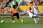 Matt Doherty slips Zakarya Bergdich during the Sky Bet Championship match between Wolverhampton Wanderers and Charlton Athletic at Molineux, Wolverhampton, England on 29 August 2015. Photo by Alan Franklin.