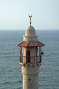 Israel, Tel Aviv - Jaffa, The turret of the El Baher mosque in old Jaffa the Mediterranean sea in the background August 2005