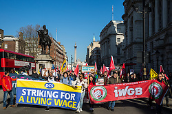 London, UK. 26th February, 2019. Mainly migrant striking outsourced workers belonging to the Independent Workers of Great Britain (IWGB), United Voices of the World (UVW) and Public and Commercial Services Union (PCS) trade unions working at the University of London (IWGB), Ministry of Justice (UVW) and Department for Business Energy and Industrial Strategy (PCS), together with representatives of the National Union of Rail, Maritime and Transport Workers (RMT) Regional Council, take part in a 'Clean Up Outsourcing' demonstration to call for an end to the practice of outsourcing. The demonstration was organised to coincide with a significant High Court hearing of an application by the IWGB for judicial review of a decision by the Central Arbitration Committee (CAC) not to hear their application for trade union recognition for the purposes of collective bargaining with the University of London.
