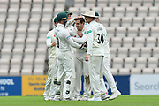 Wicket - Daryl Mitchell of Worcestershire is mobbed after taking the wicket of Liam Dawson of Hampshire during the Specsavers County Champ Div 1 match between Hampshire County Cricket Club and Worcestershire County Cricket Club at the Ageas Bowl, Southampton, United Kingdom on 13 April 2018. Picture by Graham Hunt.