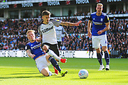 Birmingham City defenderMarc Roberts (4) tackles Derby County forward Jamie Paterson (7) during the EFL Sky Bet Championship match between Derby County and Birmingham City at the Pride Park, Derby, England on 28 September 2019.