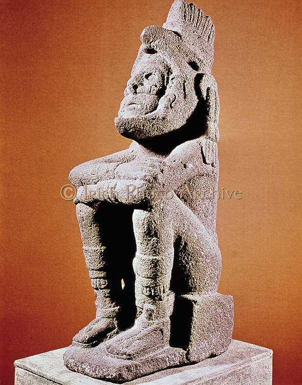 Aztec sculpture of seated male figure. Reissmuseum, Zeughaus, Mannheim .