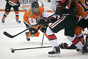 RIT's Haley Horthcote chases a loose puck during an exhibition game at RIT's Gene Polisseni Center on Monday, September 29, 2014.