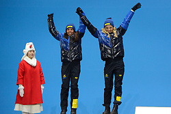 February 22, 2018 - Pyeongchang, South Korea - CHARLOTTE KALLA and STINA NILLSON of Sweden celebrate getting the silver medal in the Ladies' Team Sprint Free cross-country skiing event in the PyeongChang Olympic Games. (Credit Image: © Christopher Levy via ZUMA Wire)