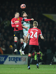 Yeovil Town's Joe Edwards battles for the high ball with Manchester United's Wayne Rooney  - Photo mandatory by-line: Joe meredith/JMP - Mobile: 07966 386802 - 04/01/2015 - SPORT - football - Yeovil - Huish Park - Yeovil Town v Manchester United - FA Cup - Third Round