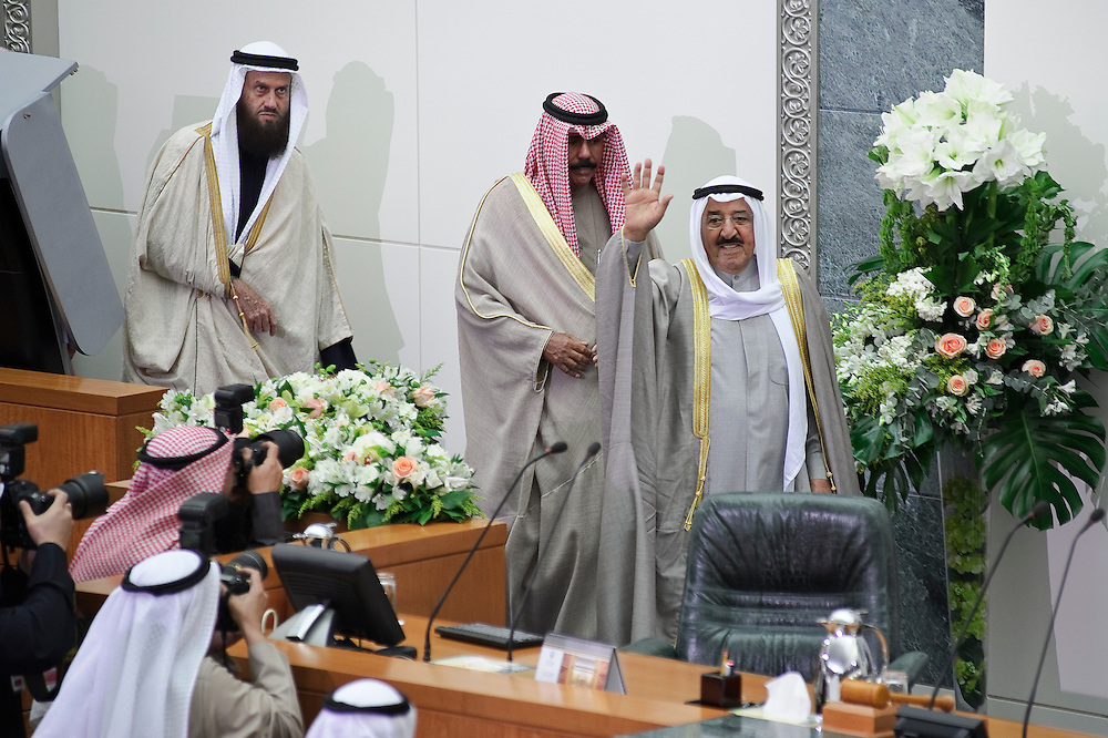 HH the Emir Sheikh Sabah Al-Ahmad Al-Jaber Al-Sabah waves to the crowd inside the National Assembly in Kuwait City Feb. 15, 2012, at the outset of the inauguration ceremony of the new parliament. HH the Crown Prince Sheikh Nawaf Al-Ahmad Al-Jaber Al- Sabah stands beside (middle of picture) and MP Khaled Sultan (Left) stand behind him. Kuwaitis voted Feb. 2 for a new 50-member legislature.