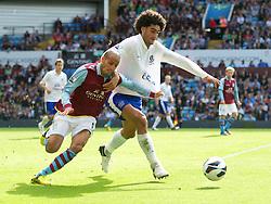 BIRMINGHAM, ENGLAND - Saturday, August 25, 2012: Everton's Marouane Fellaini in action against Aston Villa's Karim El Ahmadi during the Premiership match at Villa Park. (Pic by David Rawcliffe/Propaganda)