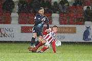 Jay O'Shea and Cameron Pring  during the EFL Sky Bet League 2 match between Cheltenham Town and Bury at LCI Rail Stadium, Cheltenham, England on 5 March 2019.