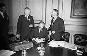 Candidates Nominated for Presidency. Mr. T.F. O'Higgins T.D., Fine Gael, who was nominated for the presidency, signing the papers of Mr. Hussey as his election agent in the presence of the returning officer Mr. Shane O'Hanlon at the Custom House, Dublin..10.05.1966