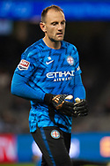 Melbourne City goalkeeper Eugene Galekovic (18) during warmup at the Hyundai A-League Round 1 soccer match between Melbourne Victory and Melbourne City FC at Marvel Stadium in Melbourne.
