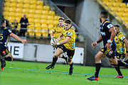 Beauden Barrett runs during the super rugby union  game between Hurricanes  and Highlanders, played at Westpac Stadium, Wellington, New Zealand on 24 March 2018.  Hurricanes won 29-12.
