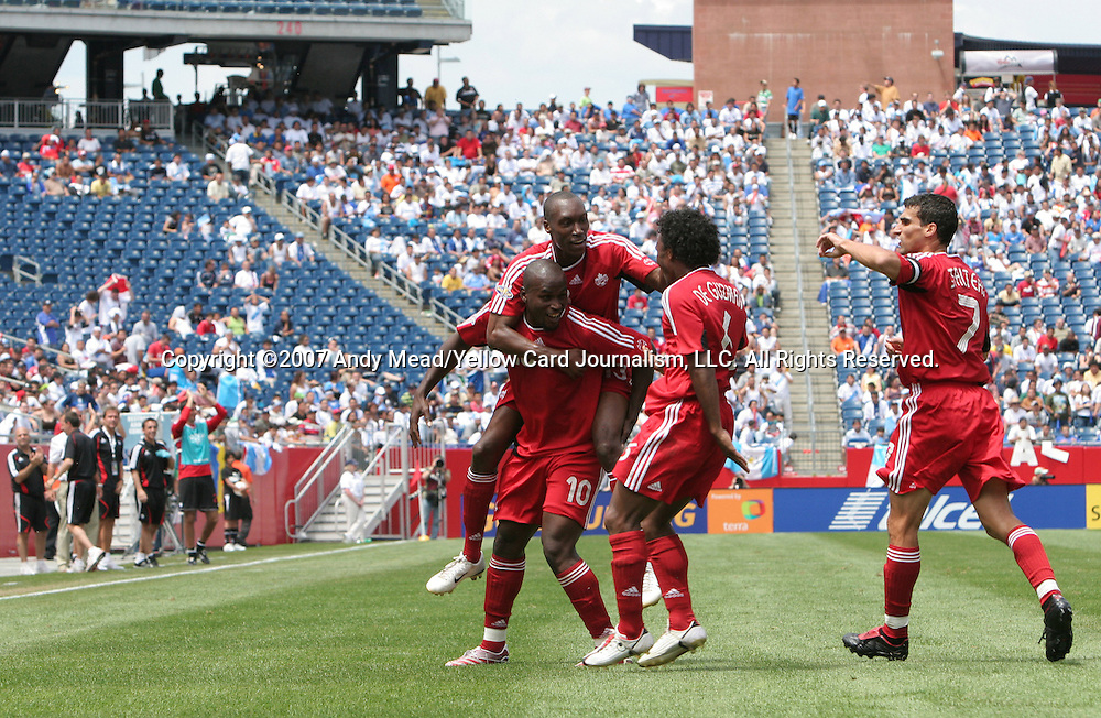 16 June 2007: Canada's Ali Gerba (10) celebrates with Atiba Hutchinson (behind), Julian DeGuzman (6), and Paul Stalteri (7) after scoring a goal in the 33rd minute. The Canada Men's National team defeated the Guatemala Men's National Team 3-0 at Gillette Stadium in Foxboro, Massachusetts in a 2007 CONCACAF Gold Cup quarterfinal.