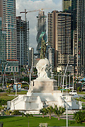 Balboa monument and skycrapers on background. Cinta Costera bayside road, Panama City, Panama, Central America..