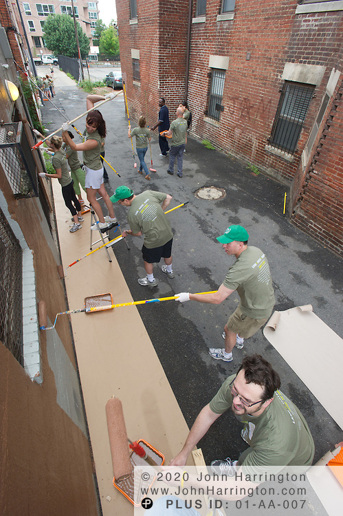Volunteers from Discovery Communications participate in their annual, international Discover Your Impact Day, a day dedicated to community service, by painting the rear of Martha's Table, a source of food and clothing for low-income and homeless people in Washington, DC on June 17th, 2011.