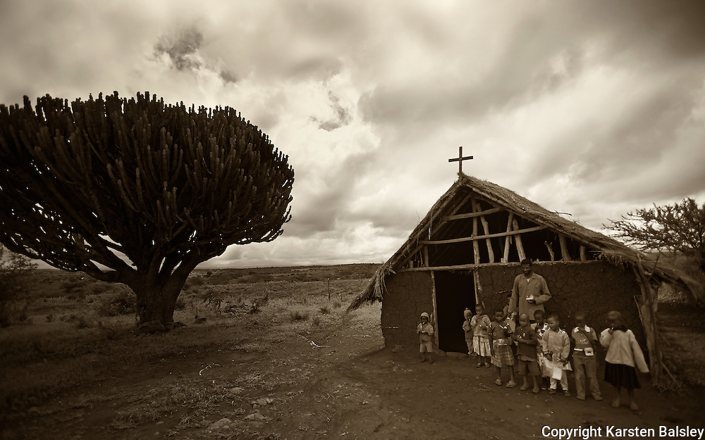 &ldquo;African Schoolhouse&rdquo;                                        Tanzania<br />  A bench, a tree, a building/church. These are the schools of Africa.
