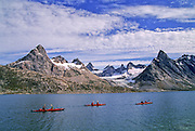 EAST GREENLAND, Sea Kayaking, Ikasartivaq Fjord, paddlers, mountains