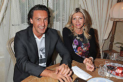VADIM LAPIN and his wife ANOUSHKA at an afternoon tea party in aid of the Naked Heart Foundation held at Mari Vanna, Wellington Court, 116 Knightsbridge, London on 29th August 2012.