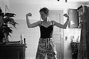 Tzara flexing her muscles, UK, 1980s