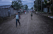 Young local boys play in the cool evening air on the streets of Shashemena.  Ethiopia.