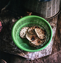 Tortillas in basket in the village San Gregorio. For many families, the everyday food consists in large of tortillas with some beans and possibly some vegetables. Malnutrition is often not seen on the outside - 75 percent of children who will die from malnutrition show no obvious signs of starvation. The life threatening injuries are internal and especially damage the barin.