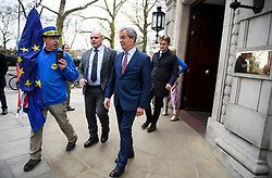 © Licensed to London News Pictures. 29/03/2018. London, UK. Former UKIP leader NIGEL FARAGE is seen being confronted by anti-Brexit campaigners while leaving Milbank Studio's following an appearance on the BBC Daily Politics program. . Photo credit: Ben Cawthra/LNP