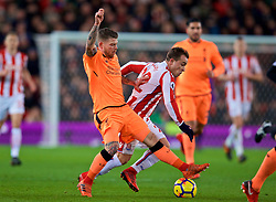 STOKE-ON-TRENT, ENGLAND - Wednesday, November 29, 2017: Liverpool's Alberto Moreno disposses Stoke City's Xherdan Shaqiri during the FA Premier League match between Stoke City and Liverpool at the  Bet365 Stadium. (Pic by David Rawcliffe/Propaganda)