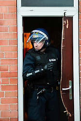 EMBARGO UNTILL 13:00 4th MARCH 2014<br /> After a forced entry using a chainsaw South Yorkshire Police Officers execute a Warrant at an address in Eastwood Rotherham early on Tuesday Morning<br /> <br /> 04 March 2014<br /> Image © Paul David Drabble <br /> <br /> www.pauldaviddrabble.co.uk