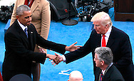Donald Trump  and Barack Obama shake hands after Trump makes he Inauguratl speech after he takes the oath of office for the presidency of the United States on January 20,2017<br /> <br /> Photo by Dennis Brack
