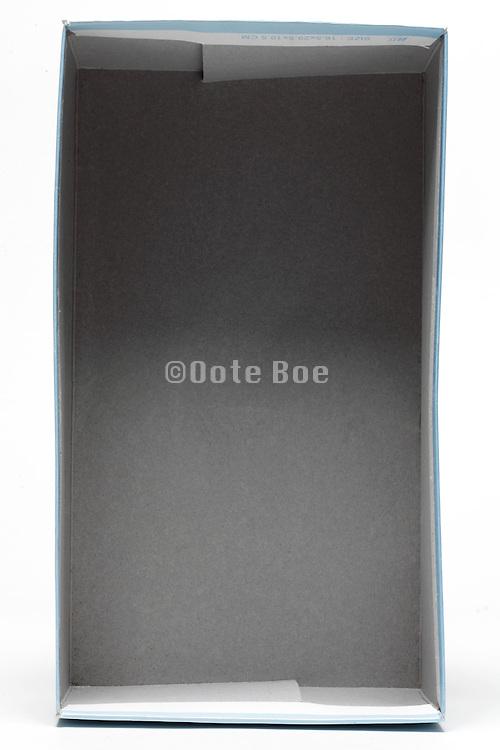 inside of an empty gray carton shoe box