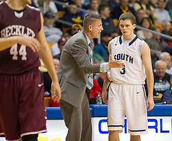 Parkersburg South Head Coach Mike Fallon talks with Parkersburg South guard Cody Monroe (3) during a semi-final game at the Charleston Civic Center.