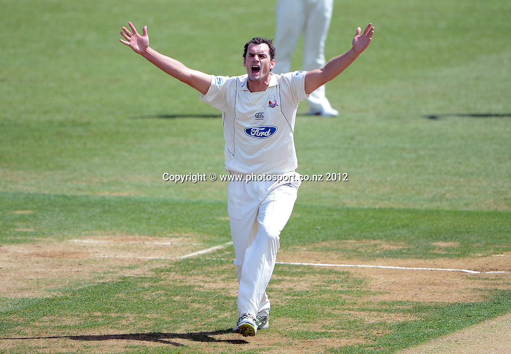 Kyle Mills appeals. Plunket Shield Cricket, Auckland Aces v Canterbury Wizards at Eden Park Outer Oval. Auckland on Sunday 16 December 2012. Photo: Andrew Cornaga/Photosport.co.nz