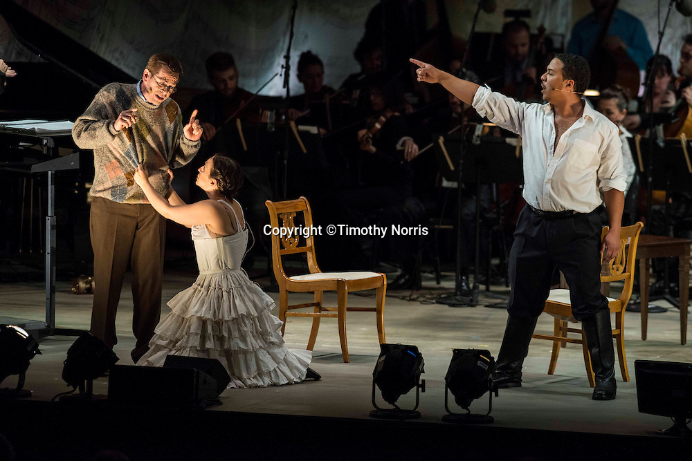 "Keith Jameson (tenor) as ""Snibblesworth"", Jennifer Zetlan (soprano) as ""Donna Anna"" and Aubery Allicock (bass-baritone) as ""Don Giovanni"" in the world premiere of Steven Stucky and Jeremy Denk's The Classical Style: An Opera (of Sorts) at the 68th Ojai Music Festival at Libbey Bowl on June 13, 2014 in Ojai, California."