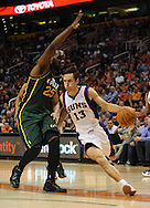 Mar. 14, 2012; Phoenix, AZ, USA; Phoenix Suns guard Steve Nash (13) drives the ball against the Utah Jazz center Al Jefferson (25) during the first half at the US Airways Center. The Suns defeated the Jazz 120-111. Mandatory Credit: Jennifer Stewart-US PRESSWIRE.