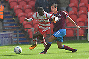 Scunthorpe United midfielder Josh Morris (11) and Doncaster Rovers player Rodney Kongolo (7)  during the EFL Sky Bet League 1 match between Doncaster Rovers and Scunthorpe United at the Keepmoat Stadium, Doncaster, England on 17 September 2017. Photo by Ian Lyall.