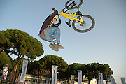 Extreme Bicycle sport jump The rider hanging below the bike