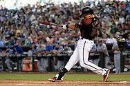 Apr 22, 2017; Phoenix, AZ, USA; Arizona Diamondbacks third baseman Jake Lamb (22) hits a two run home against the Los Angeles Dodgers in the first inning at Chase Field. Mandatory Credit: Jennifer Stewart-USA TODAY Sports