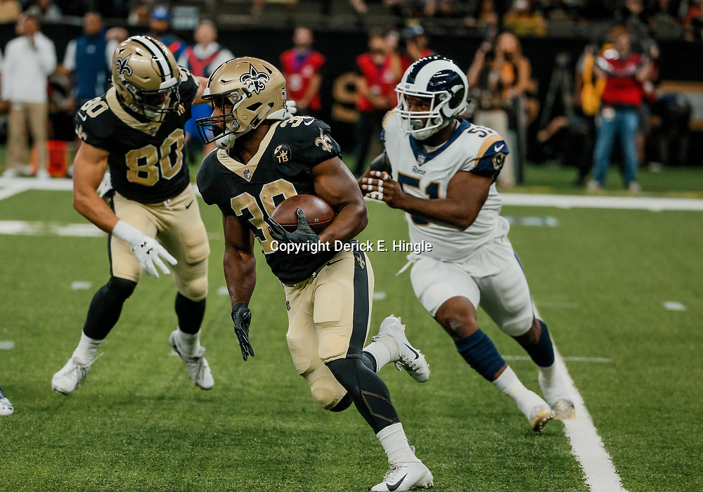 Aug 30, 2018; New Orleans, LA, USA; New Orleans Saints running back Boston Scott (30) runs past Los Angeles Rams linebacker Ejuan Price (51) during the first half of a preseason game at the Mercedes-Benz Superdome. Mandatory Credit: Derick E. Hingle-USA TODAY Sports