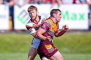 Bradford Bulls scrum half Joe Keyes (7) in a tackle during the Kingstone Press Championship match between Batley Bulldogs and Bradford Bulls at the Fox's Biscuits Stadium, Batley, United Kingdom on 16 July 2017. Photo by Simon Davies.
