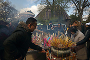 Cambodian buddhists lighting incense during the Khmer New Year celebrations at the Great Pagoda of the Bois de Vincennes, in the 12th arrondissement of Paris, France, photographed on 14th April 2019. Cambodians celebrate the entrance of the sun to the constellation of the ram, marking the beginning of the Buddhist year 2563. Khmer New Year or Chaul Chnam Thmey marks the end of the dry season and Cambodians celebrate by bringing offerings to temples or wats. Picture by Manuel Cohen