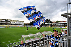 A Bath supporter waves a giant flag at the Memorial Stadium prior to the match - Mandatory byline: Patrick Khachfe/JMP - 07966 386802 - 13/09/2015 - RUGBY UNION - Memorial Stadium - Bristol, England - Gloucester Rugby v Bath Rugby - West Country Challenge Cup.