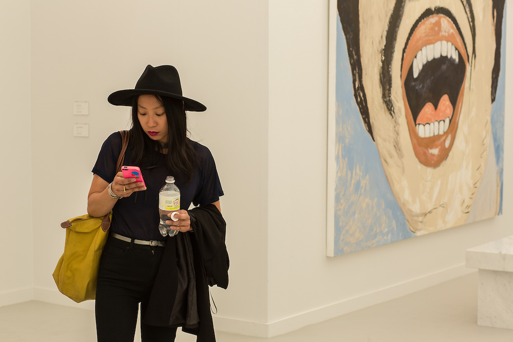 A woman in the gallery of Cheim & Reid, a New York gallery.