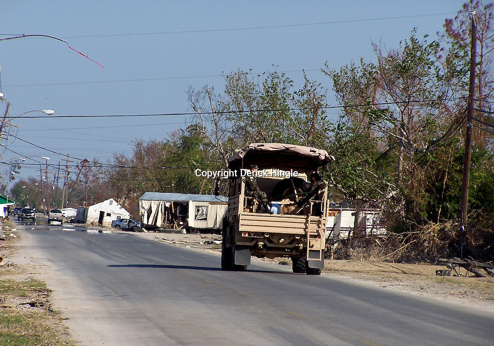 Scenes of devastation left in the aftermath of Hurricane Katrina that flooded the small city of Buras, Louisiana in Plaquemines Parish on August 29, 2005. A military vehicle patrols the streets of Buras...(Mandatory Credit: Photo by Derick E. Hingle)