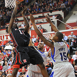 Rutgers Scarlet Knights guard/forward Dane Miller (11) lays in a basket over Seton Hall Pirates forward Herb Pope (15) during second half Big East NCAA Basketball between the Rutgers Scarlet Knights and Seton Hall Pirates at the Louis Brown Athletic Center. Seton Hall defeated Rutgers 59-55.