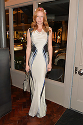 OLIVIA INGE at a dinner to celebrate 20 years of Maria Grachvogel's fashion label held at Salmontini, 1 Pont Street, London on 22nd October 2014.