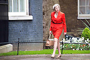 Photographer: Rick Findler<br /> <br /> London UK. 08.05.15 Reappointed Home Secretary Theresa May walks into 10 Downing Street to meet with the Prime Minister David Cameron. Cameron appeared triumphant today as he was the doctor in becoming the new Prime Minster in the 2015 general election.