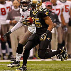 January 2, 2011; New Orleans, LA, USA; New Orleans Saints running back Reggie Bush (25) runs from Tampa Bay Buccaneers linebacker Geno Hayes (54) during the first quarter at the Louisiana Superdome. Mandatory Credit: Derick E. Hingle