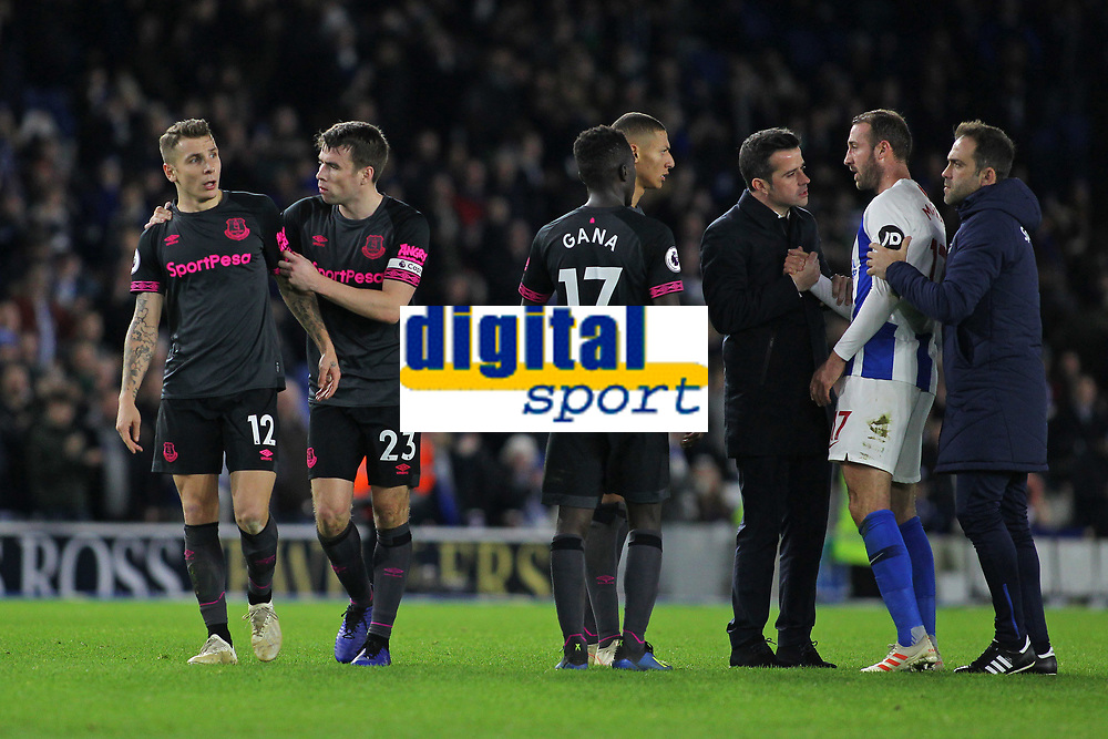 Football - 2018 / 2019 Premier League - Brighton and Hove Albion vs. Everton<br /> <br /> Everton captain Seamus Coleman steps in to move Lucas Digne of Everton away from Glenn Murray of Brighton after the two players squared up after the final whistle at The Amex Stadium Brighton <br /> <br /> COLORSPORT/SHAUN BOGGUST