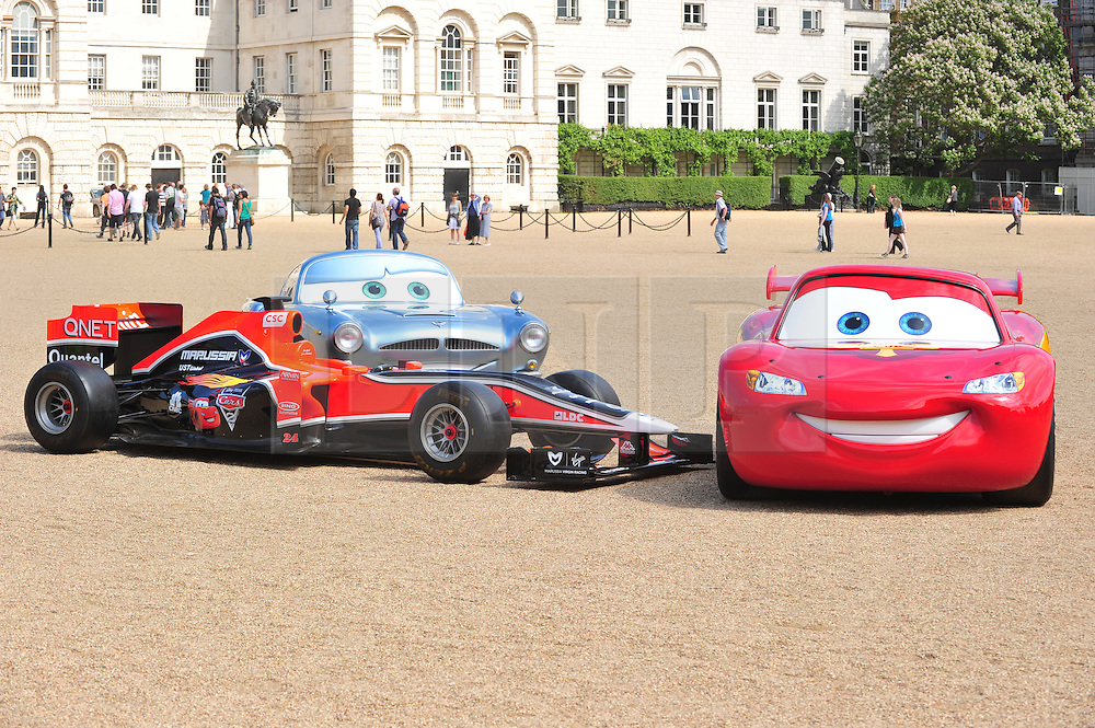 © licensed to London News Pictures. LONDON UK  04/07/11. Richard and Holly Branson pose with the Virgin Formula one car and two cars from the new Disney Pixar movie Cars 2 in cinemas later this month , photocall in Horse Guards Parade London. Please see special instructions for usage rates. Photo credit should read ALAN ROXBOROUGH/LNP
